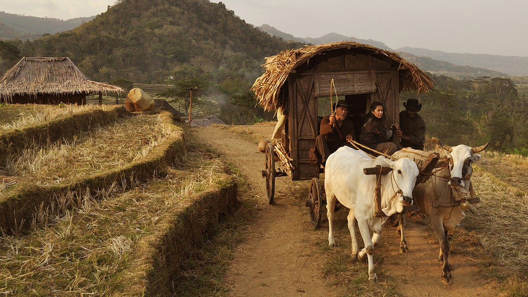 A wagon rolls through Southeast Asian countryside terraces. - PHOTO COURTESY SAMUEL GOLDWYN FILMS/INFINITE STUDIO