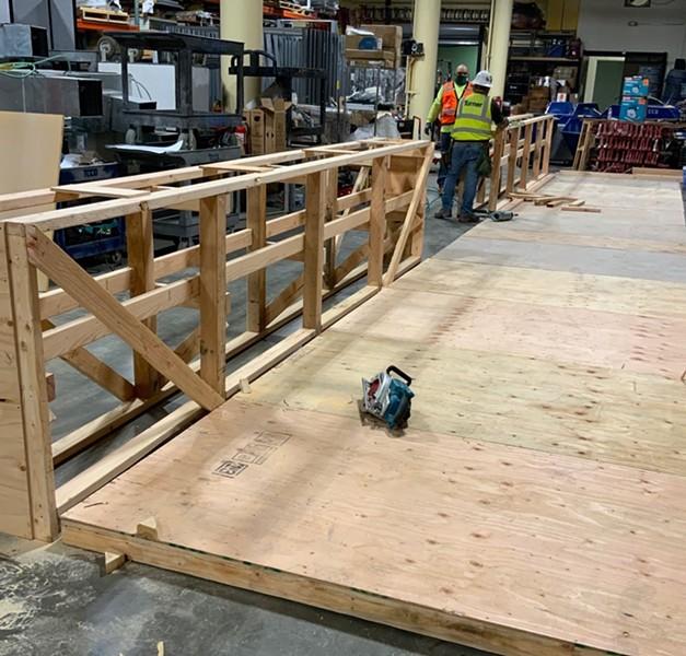 OIA pro bono partners Turner Construction building a parklet for Sobre Mesa. - OAKLAND INDIE ALLIANCE