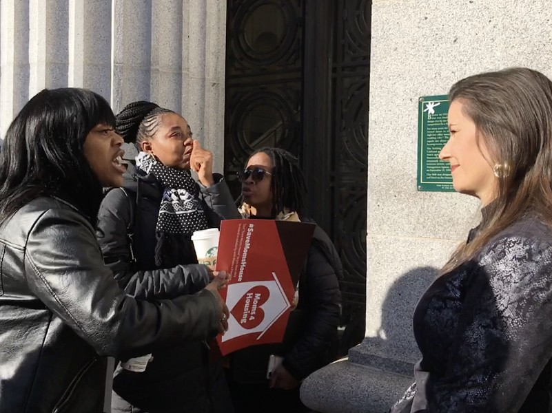 Moms 4 Housing activists making their case to Oakland Mayor Libby Schaaf in January at City Hall. - STEVEN TAVARES
