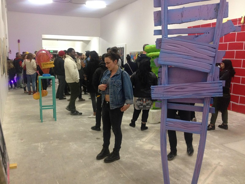 The scene at one of New Normal's recent art openings (via Facebook).