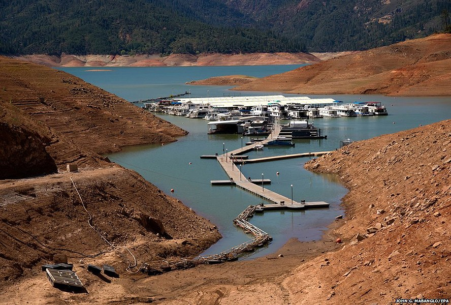 Dam proponents hope to take advantage of the current drought to increase the size of Shasta Lake. But environmentalists note that there is not much water available to fill up a larger reservoir. - JOHN MABANGLO/EPA