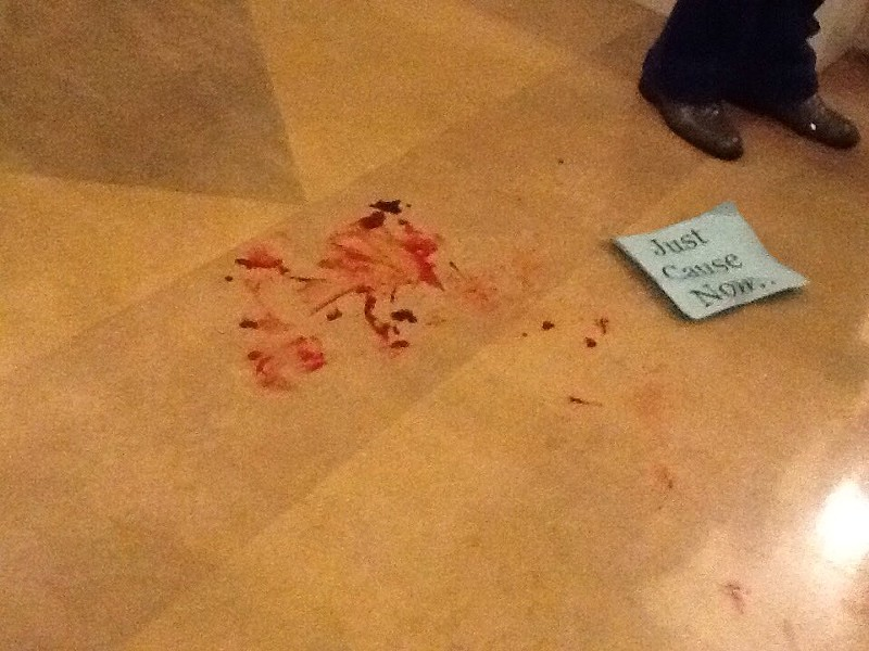 Blood from the man thrown to the ground by Alameda police in City Hall. - STEVEN TAVARES