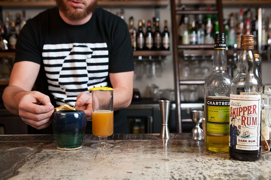 Jared Berry makes holiday drinks at East Bay Spice Company. - BERT JOHNSON