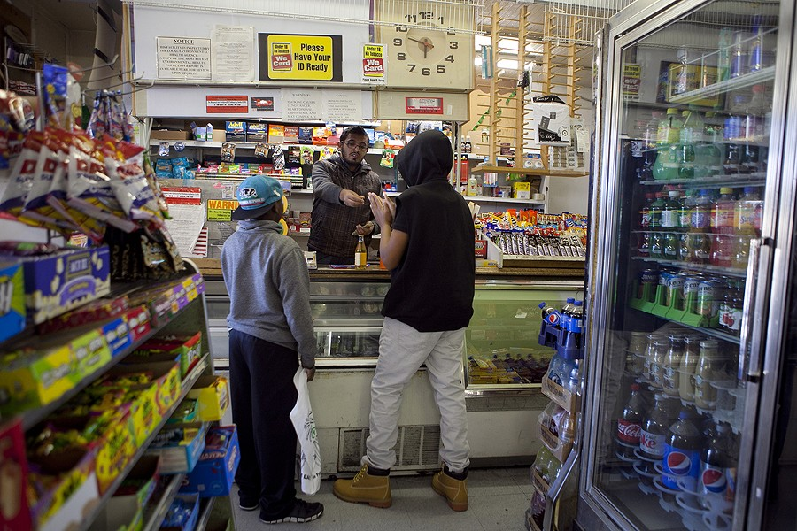 Galal Al-Hadhrami rings up items for two young boys at Friendly Market in Berkeley, one of two corner stores chosen to participate in the city's Healthy Foods, Healthy Neighborhoods program. - ERIN BALDASSARI