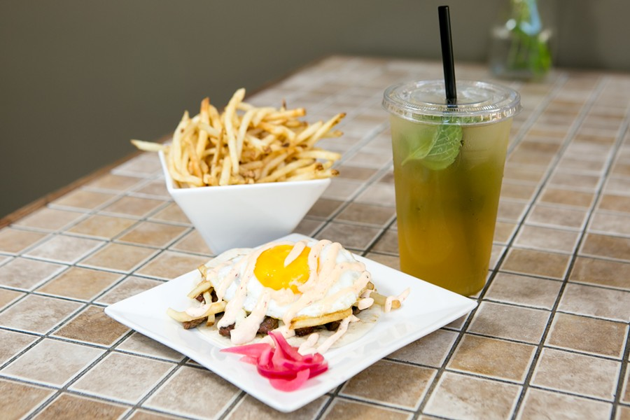 Steak & eggs taco, fries, and iced tea at Belly. - BERT JOHNSON