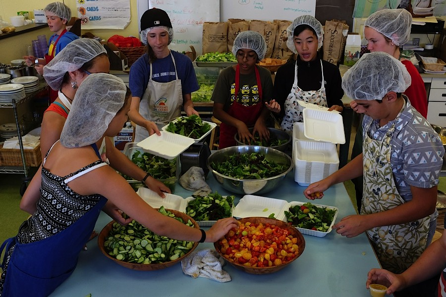 Students in the Growing Leaders class pack a salad. - MATT TSANG