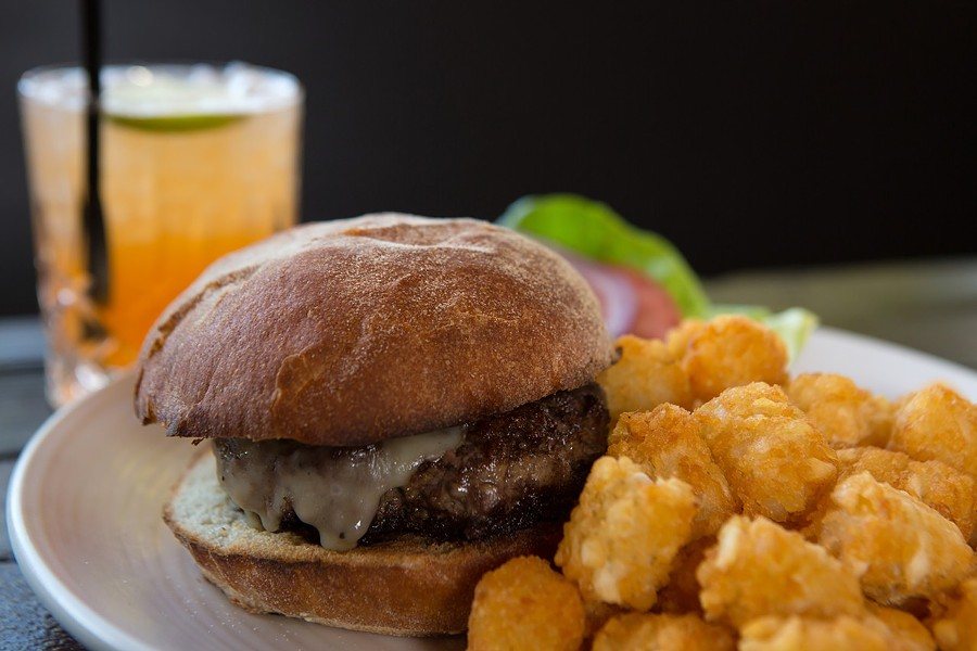 The burger and tater tots at Handlebar. - BERT JOHNSON/FILE PHOTO