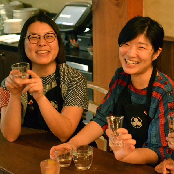 Umami Mart co-owners Kayoko Akabori and Yoko Kumano enjoy some sake.