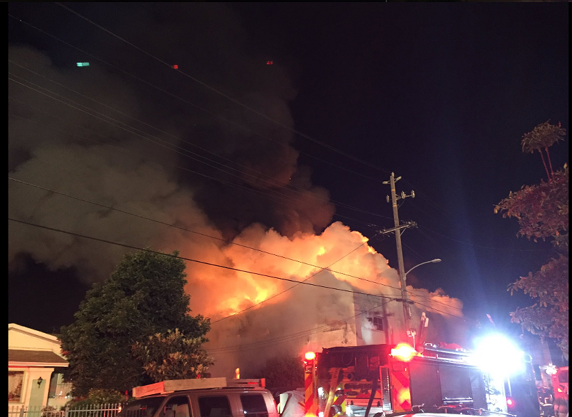 Last night's fire at the Ghostship party in Oakland's Fruitvale District. - PHOTO BY SEUNG LEE