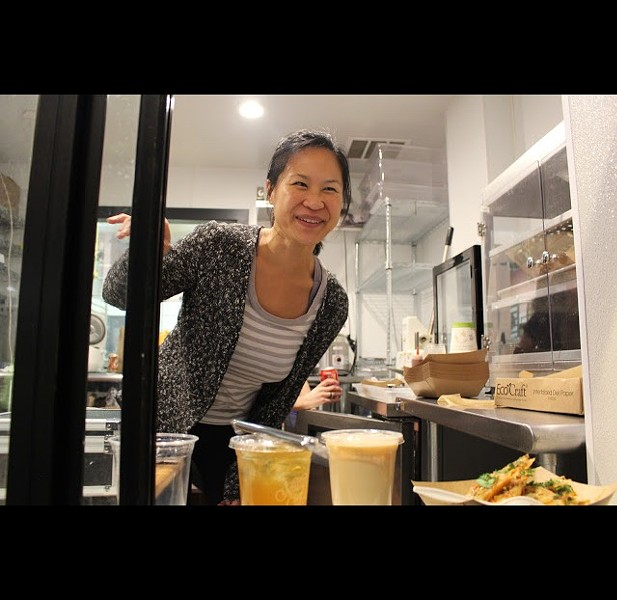 Proprietor Sophia Chang at the Kitchener Snack Bar window. - HAILEY ZHOU
