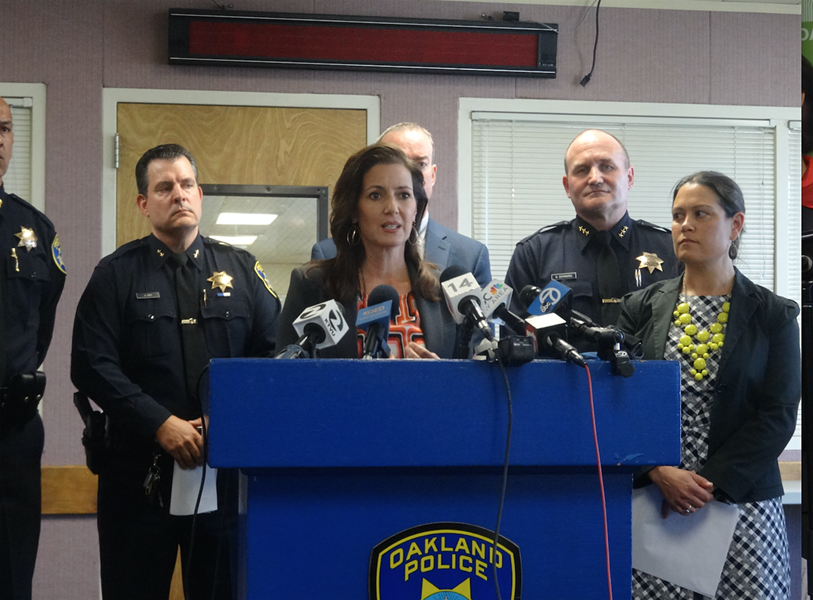 Oakland Mayor Libby Schaaf and City Administrator at a press conference last October. - DARWIN BONDGRAHAM