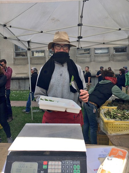 Riverdog Farms owner Tim Mueller says he wanted to set up at the farmers market despite the possibility of a brawl in downtown Berkeley. - PHOTO BY GABRIELLE CANON