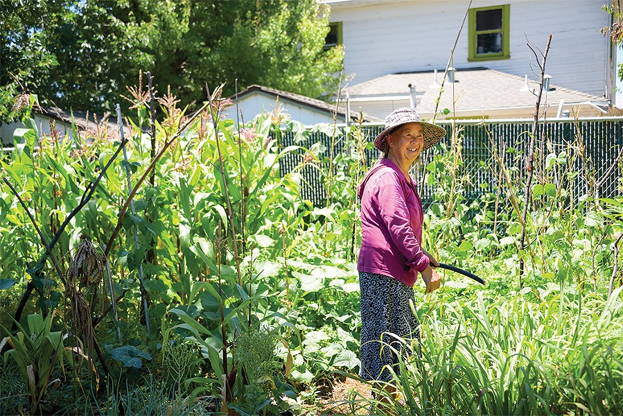 Mey Yan Saechao, one of the Mien gardeners. - PHOTO BY BRIAN BRENEMAN