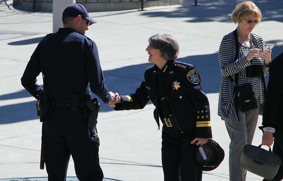 Police Chief Anne Kirkpatrick greets a police officer. - ALI WINSTON