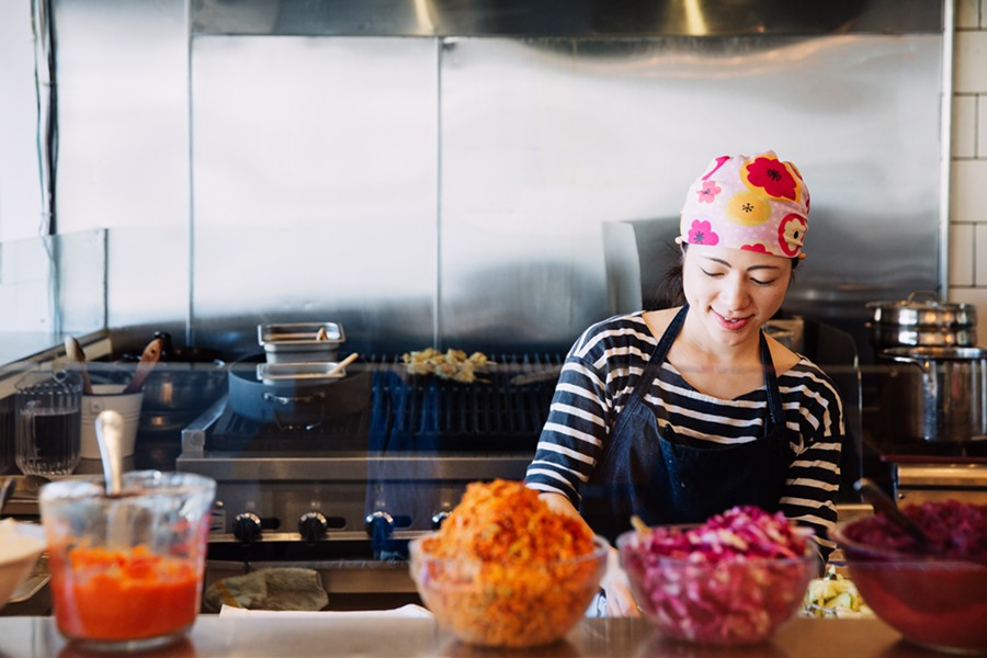 Executive chef Traci Matsumoto-Esteban works the grill and assembly line. - ANDRIA LO