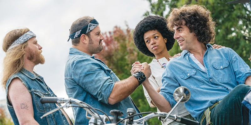 YIPPIES UNITE:  Sacha Baron Cohen, far right, stars as famous Youth International Party co-founder Abbie Hoffman in 'The Trial of the Chicago 7,' which debuts Friday on Netflix.
