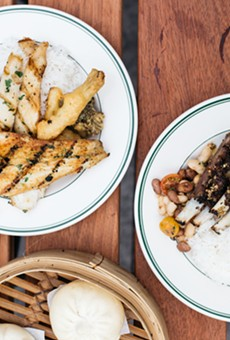 At lunch, most diners assemble rice plates from pre-made dishes, such as beans, lamb belly, and mushrooms (right).
