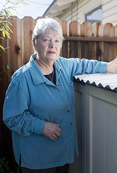 Sylvia Hopkins has found toxic dust from coal and petcoke shipments on her home.