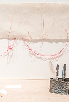 Cecilia Vicuña incorporates found objects into her installations.