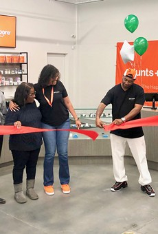 (Left to right) Phae Moore, mother of co-owner Brittany Moore; Assistant to the City Administrator Greg Minor; Councilmember Desley Brooks; co-owner Brittany Moore; co-owner Alphonso Blunt Jr.; and Alphonso's wife Kimberlee Blunt at the ribbon cutting for the dispensary's opening last week.