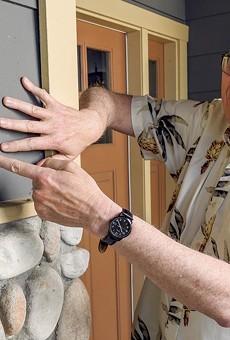 Ken Benson shows off his fire resistant siding.