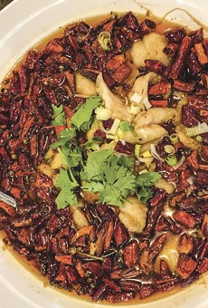 Wojia Hunan Cuisine's red chili fish is complex and spicy