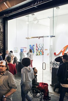 An opening reception at White Walls in 2014.