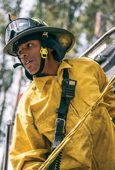 Paul Mason listens to an officer during a wildland training exercise in the Oakland hills. Since the 1991 firestorm, academy recruits are rigorously trained on more extensive wildland firefighting equipment.