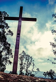 The Albany Lions Club has steadfastly refused to remove a giant cross on Albany hill.