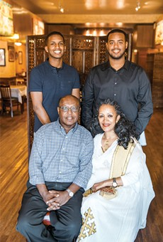 Brothers Yonathan Yohannes and Benyam Yohannes (top left-to-right) might run Asmara Restaurant one day. That's what their parents Kesete Yohannes and Okba R. Yohannes hope for, at least.