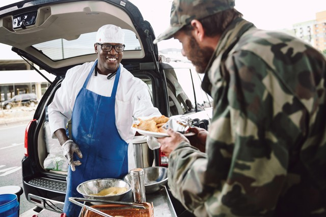 Chef Pat cooks meals for homeless people on Fridays in Oakland. - PHOTO BY KALA MINKO