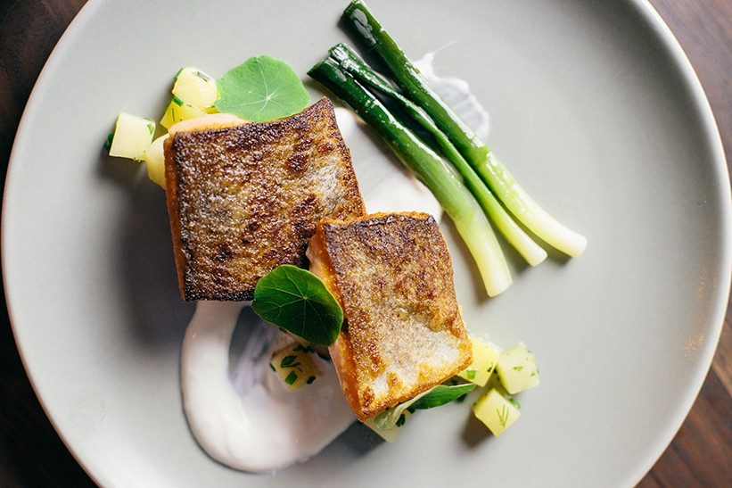 Trout with glazed root vegetables, leeks, ginger, and yogurt. - PHOTO BY MELATI CITRAWIREJA