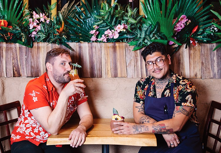Owner Christ Aivaliotis sits with chef Manuel Bonilla — in Hawaiian shirts, of course. - PHOTO BY MELATI CITRAWIREJA