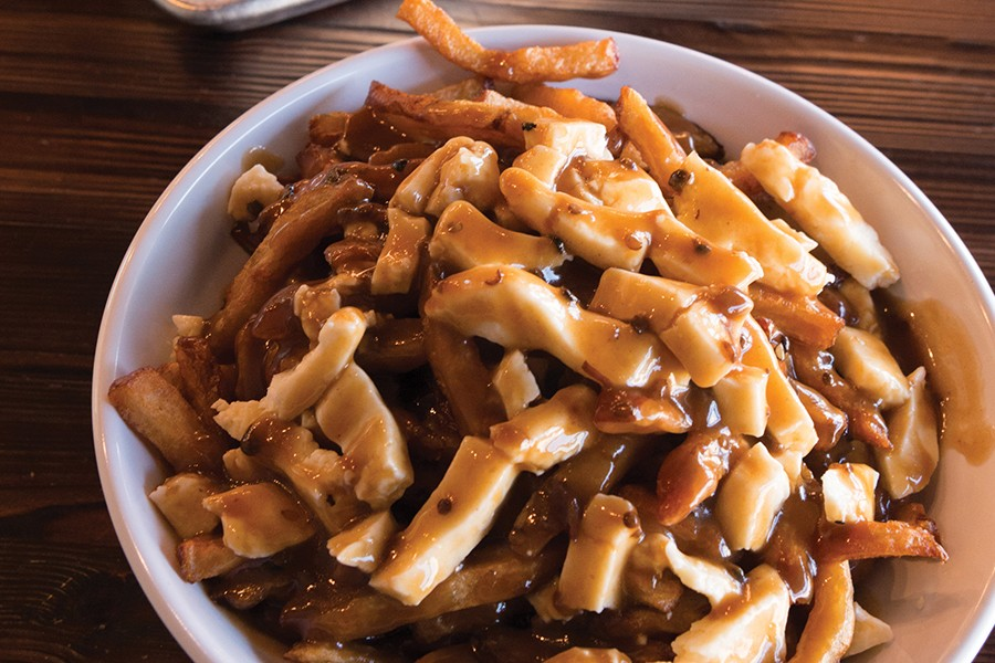 The poutine is simple and traditional, finished with squeaky cheese curds. - PHOTO BY LANCE YAMAMOTO