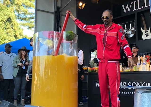 Snoop Dogg stirrring the biggest paradise cocktail in the world, according to the Guinness World Records. - PHOTO BY MAYRA ALFARO MARTINEZ