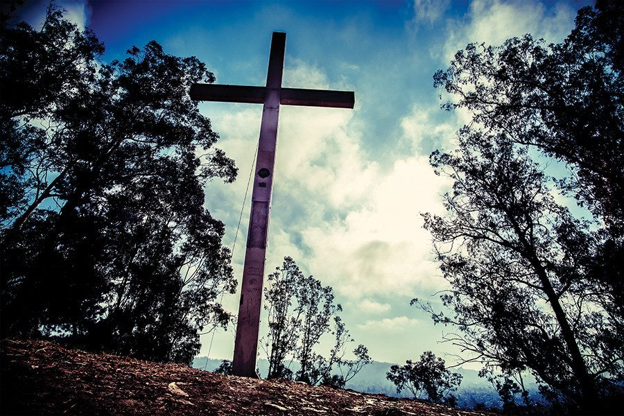 The cross on Albany Hill has long been a source of controversy. - PHOTO BY DARRYL BARNES