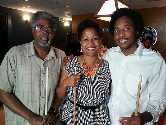 Victor McElhaney, right, with his parents, celebrating his birthday. - LYNETTE MCELHANEY