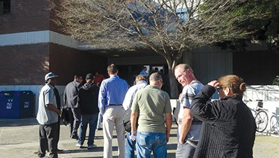 A line forms outside the Hayward Hall of Justice last February. - DARWIN BONDGRAHAM