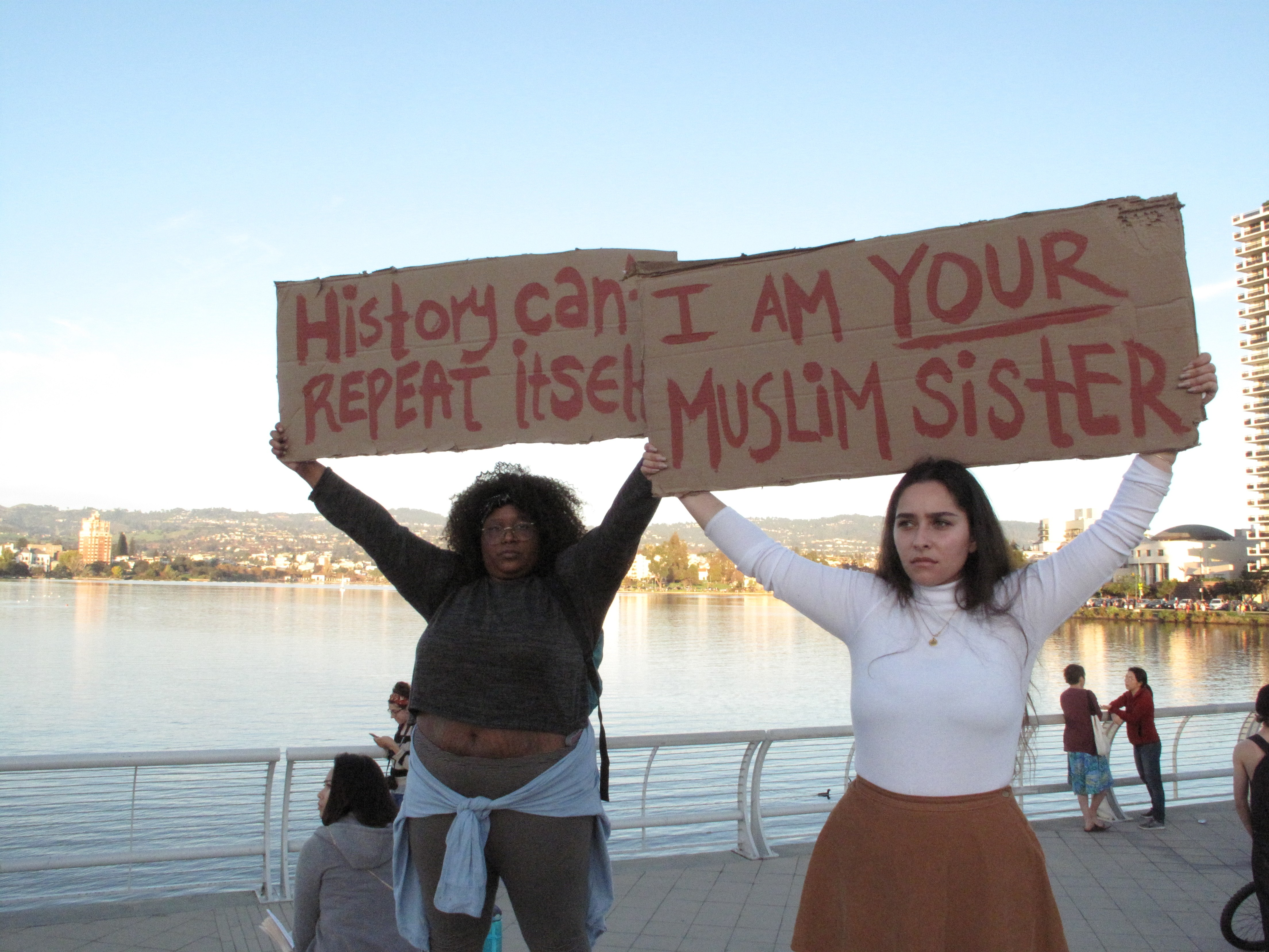 protesters join hands around lake merritt in oakland to protest