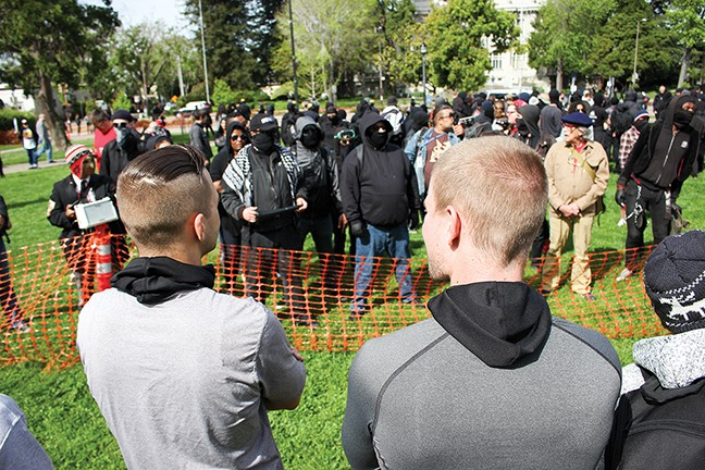 Two members of RAM face off with Antifa in Berkeley in April. - PHOTO BY BRIAN KRANS