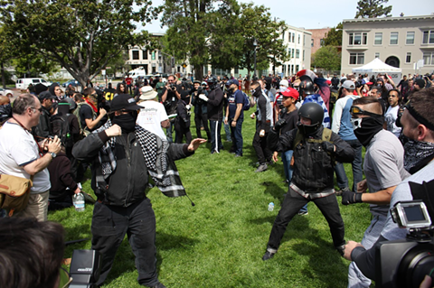 Trump supporters face off against anti-fascists on April 15 in Berkeley. - BRIAN KRANS