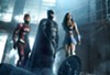 Ezra Miller, Ben Affleck, and Gal Gadot team up in <i>Justice League.</i>