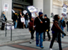 A picket outside Oakland City Hall during the seven day strike in December.