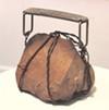 <i>Portable Burden</i> turns a rock into a purse.