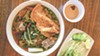 The goat egg noodle soup is a star on the menu.