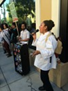 Former employee and lawsuit plaintiff Flor Crisostomo leading the chants during picket of Calavera.