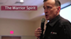 """Screenshot from a promotional video for Calibre Press' """"Bulletproof"""" training workshop showing retired Army Lt. Col. Dave Grossman speaking to police officers."""