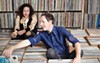Hannah Lew (L) and Andrew Kerwin are opening Contact Records in a shipping container.