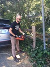 Josh Harkinson used a chainsaw to remove his fence on Sunday.