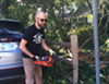 Josh Harkinson used a chainsaw to remove his fence.